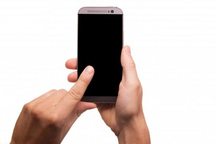 2-man-using-mobile-phone